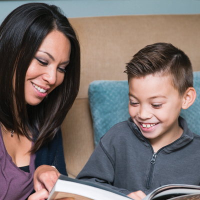 Boy and mother reading